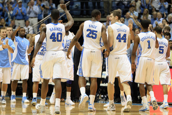 CHAPEL HILL, NC - FEBRUARY 27:  Teammates Justin Knox #25 and Tyler Zeller #44 of the North Carolina Tar Heels celebrate with teammates as they walk back to the bench during their game against the Maryland Terrapins at the Dean E. Smith Center on February