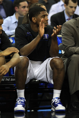 CHARLOTTE, NC - MARCH 18:  Kyrie Irving #1 of the Duke Blue Devils cheers from the bench in the first half while taking on the Hampton Pirates during the second round of the 2011 NCAA men's basketball tournament at Time Warner Cable Arena on March 18, 201