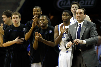 CHARLOTTE, NC - MARCH 18:  (R) Head coach Mike Krzyzewski of the Duke Blue Devils and the rest of the Blue Devils bench cheer after a basket by Andre Dawkins #20 while taking on the Hampton Pirates during the second round of the 2011 NCAA men's basketball
