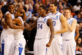 TAMPA, FL - MARCH 19:  Darius Miller #1, Brandon Knight #12, DeAndre Liggins #34, Eloy Vargas #30 and Jon Hood #4 of the Kentucky Wildcats celebrate after they won 71-63 against the West Virginia Mountaineers during the third round of the 2011 NCAA men's