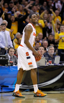 CLEVELAND, OH - MARCH 20: Scoop Jardine #11 of the Syracuse Orange reacts after turning the ball over late in the game against the Marquette Golden Eagles during the third of the 2011 NCAA men's basketball tournament at Quicken Loans Arena on March 20, 20