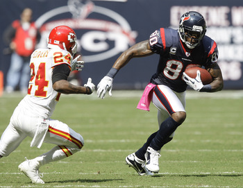 HOUSTON - OCTOBER 17:  Andre Johnson #80 of the Houston Texans makes on move on cornerback Brandon Flowers# 24 of the Kansas City Chiefs at Reliant Stadium on October 17, 2010 in Houston, Texas.  (Photo by Bob Levey/Getty Images)