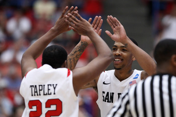 TUCSON, AZ - MARCH 19:  Chase Tapley #22 and Malcolm Thomas #4 of the San Diego State Aztecs celebrate during their game against the Temple Owls the third round of the 2011 NCAA men's basketball tournament at McKale Center on March 19, 2011 in Tucson, Ari
