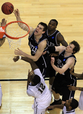 WASHINGTON - MARCH 19:  Andrew Smith #44 of the Butler Bulldogs puts up a shot against Ashton Gibbs #12 of the Pittsburgh Panthers during the third round of the 2011 NCAA men's basketball tournament at Verizon Center on March 19, 2011 in Washington, DC. B