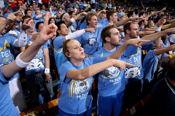 WESTWOOD, CA - DECEMBER 06:  The student section of the UCLA Bruins point at the Kansas Jayhawks as they warm up on December 6, 2009 at Pauley Pavillion in Westwood, California.  Kansas won 73-61.  (Photo by Stephen Dunn/Getty Images)