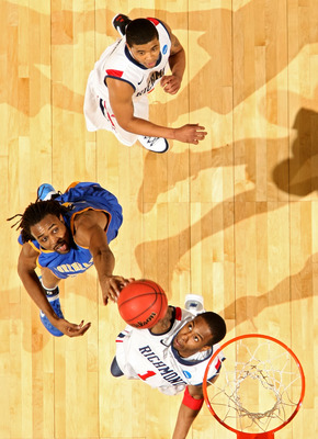 DENVER, CO - MARCH 19:  Darrius Garrett #1 of the Richmond Spiders fights for a rebound aganst Kenneth Faried #35 of the Morehead State Eagles during the third round of the 2011 NCAA men's basketball tournament at Pepsi Center on March 19, 2011 in Denver,