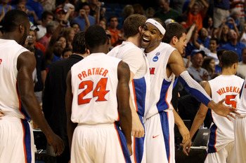 TAMPA, FL - MARCH 19:  Alex Tyus #23 of the Florida Gators celebrates with his teammates after Florida won 73-65 against the UCLA Bruins during the third round of the 2011 NCAA men's basketball tournament at St. Pete Times Forum on March 19, 2011 in Tampa