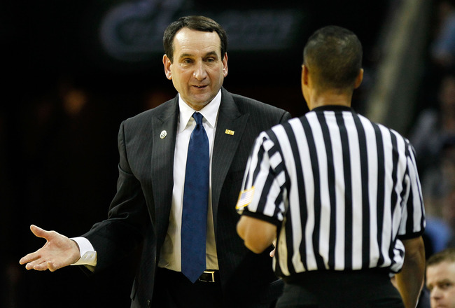 CHARLOTTE, NC - MARCH 20:  Head coach Mike Krzyzewski of the Duke Blue Devils looks over at a referee in the first half while taking on the Michigan Wolverines during the third round of the 2011 NCAA men's basketball tournament at Time Warner Cable Arena