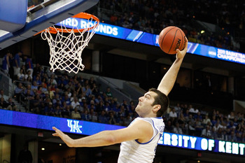 TAMPA, FL - MARCH 19:  Josh Harrellson #55 of the Kentucky Wildcats attempts a dunk against the West Virginia Mountaineers during the third round of the 2011 NCAA men's basketball tournament at St. Pete Times Forum on March 19, 2011 in Tampa, Florida.  (P