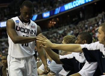 WASHINGTON - MARCH 17:  Kemba Walker #15 of the Connecticut Huskies is congratulate by teammates during their game against the Bucknell Bison during the second round of the 2011 NCAA men's basketball tournament at the Verizon Center on March 17, 2011 in W