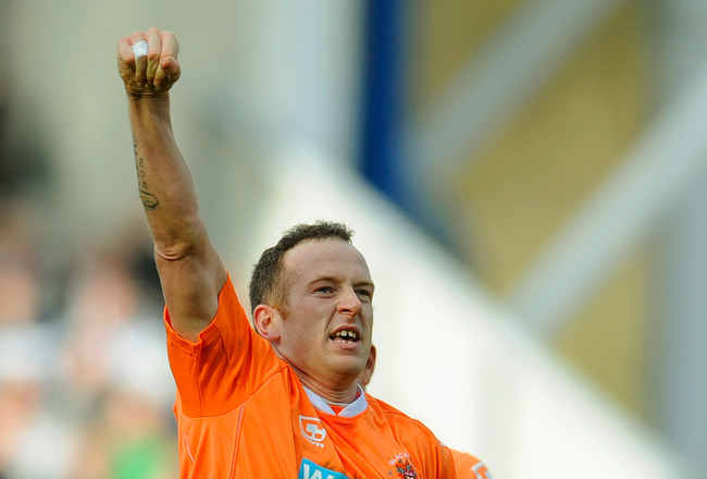 BLACKBURN, ENGLAND - MARCH 19:  Charlie Adam of Blackpool celebrates scoring to make it 1-0 during the Barclays Premier League match between Blackburn Rovers and Blackpool at Ewood Park on March 19, 2011 in Blackburn, England.  (Photo by Michael Regan/Get