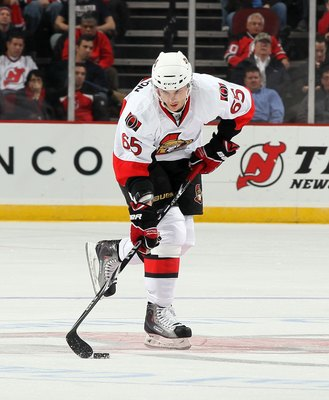 NEWARK, NJ - MARCH 08:  Erik Karlsson #65 of the Ottawa Senators skates against the New Jersey Devils at the Prudential Center on March 8, 2011 in Newark, New Jersey.  (Photo by Jim McIsaac/Getty Images)