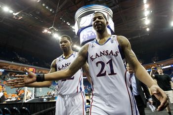 TULSA, OK - MARCH 20:  Marcus Morris #22 and Markieff Morris #21 of the Kansas Jayhawks walk off the court after defeating the Illinois Fighting Illini 59-73 in the third round of the 2011 NCAA men's basketball tournament at BOK Center on March 20, 2011 i