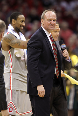 CLEVELAND, OH - MARCH 20:  Head coach Thad Matta of the Ohio State Buckeyes stands on the court with David Lighty #23 after defeating the George Mason Patriots during the third of the 2011 NCAA men's basketball tournament at Quicken Loans Arena on March 2