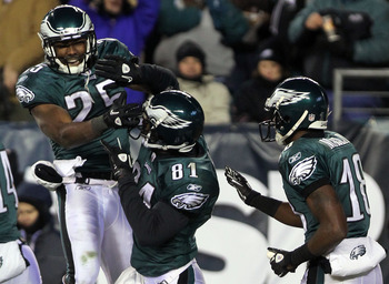 PHILADELPHIA, PA - JANUARY 09:  LeSean McCoy #25, Jason Avant #81 and Jeremy Maclin #18 of the Philadelphia Eagles celebrates Avant's third quarter touchdown against the Green Bay Packers during the 2011 NFC wild card playoff game at Lincoln Financial Fie