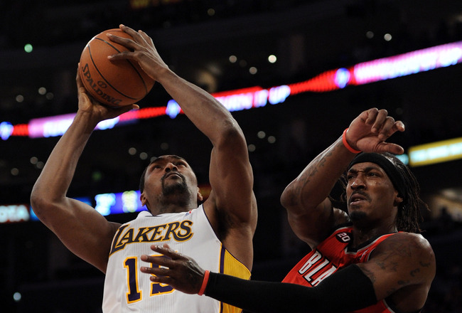 LOS ANGELES, CA - MARCH 20:  Ron Artest #15 of the Los Angeles Lakers grabs a rebound away from Gerald Wallace #3 at the Staples Center on March 20, 2011 in Los Angeles, California.  NOTE TO USER: User expressly acknowledges and agrees that, by downloadin