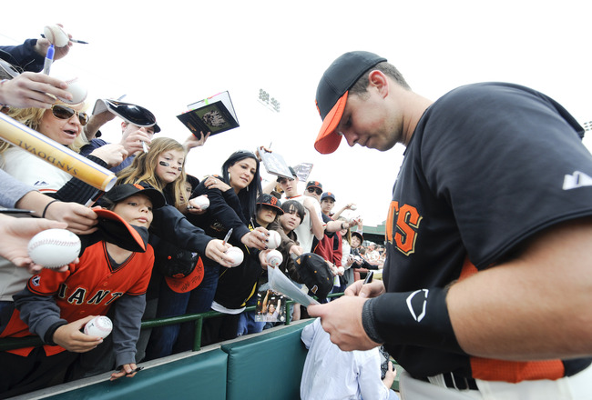 SCOTTSDALE, AZ - FEBRUARY 26: Buster Posey #28 of the San Francisco Giants signs autographs before a spring training game against the Los Angeles Dodgers at Scottsdale Stadium on February 26, 2011 in Scottsdale, Arizona. (Photo by Rob Tringali/Getty Image