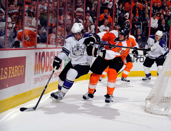 PHILADELPHIA - FEBRUARY 13:  Anze Kopitar #11 of the Los Angeles Kings battles Chris Pronger #20 of the Philadelphia Flyers on February 13, 2011 at the Wells Fargo Center in Philadelphia, Pennsylvania.  (Photo by Lou Capozzola/Getty Images)
