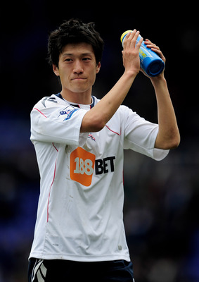BIRMINGHAM, ENGLAND - MARCH 12: Chung-Yong Lee of Bolton Wanderers applauds the fans during the FA Cup sponsored by E.On Sixth Round match between Birmingham City and Bolton Wanderers at St Andrews on March 12, 2011 in Birmingham, England.  (Photo by Jami
