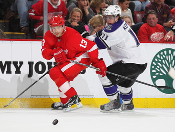 DETROIT, MI - MARCH 9:  Anze Kopitar #11 of the Los Angeles Kings tries to hold up Pavel Datsyuk #13 of the Detroit Red Wings in a game on March 9, 2011 at the Joe Louis Arena in Detroit, Michigan. The Kings defeated the Wings 2-1. (Photo by Claus Anderse