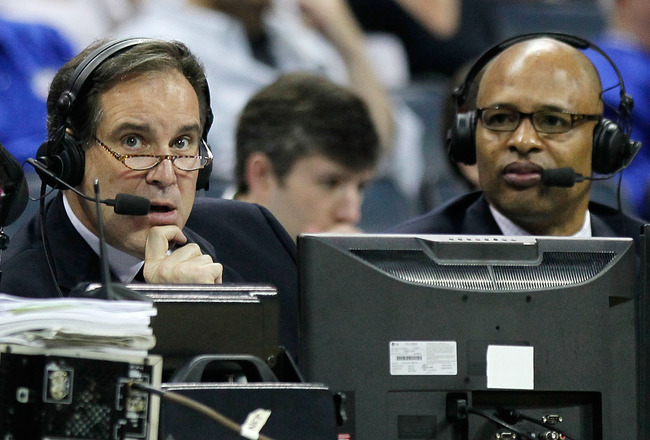CHARLOTTE, NC - MARCH 18:  Broadcasters Jim Nantz and Clark Kellogg speak during the second round of the 2011 NCAA men's basketball tournament between the Michigan Wolverines and Tennessee Volunteers at Time Warner Cable Arena on March 18, 2011 in Charlot