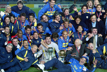 YOKOHAMA, JAPAN - DECEMBER 14: South American club champion Boca Juniors  celebrate winning the European-South American Cup club soccer championship against AC Milan at the Yokohama International stadium December 14, 2003 in Yokohama, south of Tokyo, Japa