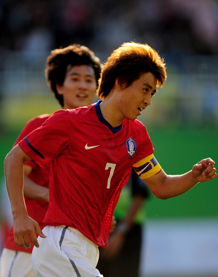 GUANGZHOU, CHINA - NOVEMBER 10:  Ja Cheol Koo of South Korea celebrates scoring the opening goal during the Men's Football Group C first round match between South Korea and Jordan ahead of the 16th Asian Games Guangzhou 2010 at Yuexiu Stadium on November