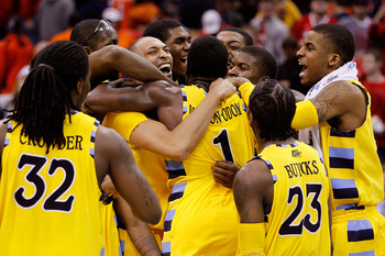 CLEVELAND, OH - MARCH 20:  Jae Crowder #32, Joseph Fulce #21, Darius Johnson-Odom #1 and Dwight Buycks #23 of the Marquette Golden Eagles celebrate with teammates after defeating the Syracuse Orange during the third of the 2011 NCAA men's basketball tourn