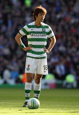 GLASGOW, SCOTLAND - OCTOBER 24:  Ki Sung Yeung of Celtic in action during the Clydesdale Bank Premier League match between Celtic and Rangers at Celtic Park on October 24, 2010 in Glasgow, Scotland.  (Photo by Clive Brunskill/Getty Images)