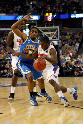 TAMPA, FL - MARCH 19:  Erving Walker #11 of the Florida Gators drives against Lazeric Jones #11 of the UCLA Bruins during the third round of the 2011 NCAA men's basketball tournament at St. Pete Times Forum on March 19, 2011 in Tampa, Florida.  (Photo by