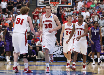 TUCSON, AZ - MARCH 19:  Mike Bruesewitz #31, Jon Leuer #30, Jordan Taylor #11 and Tim Jarmusz #24 of the Wisconsin Badgers celebrate during their 70 to 65 victory over the Kansas State Wildcats in the third round of the 2011 NCAA men's basketball tourname