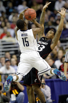 WASHINGTON - MARCH 19:  Kemba Walker #15 of the Connecticut Huskies puts up a shot in front of Sean Kilpatrick #23 of the Cincinnati Bearcats during the third round of the 2011 NCAA men's basketball tournament at Verizon Center on March 19, 2011 in Washin