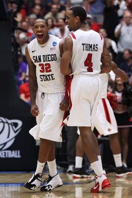 TUCSON, AZ - MARCH 19:  Malcolm Thomas #4 and Billy White #32 of the San Diego State Aztecs celebrate after defeating the Temple Owls 71 to 64 in double overtime during the third round of the 2011 NCAA men's basketball tournament at McKale Center on March