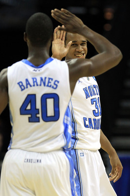 CHARLOTTE, NC - MARCH 20:  John Henson #31 and Harrison Barnes #40 of the North Carolina Tar Heels react in the second half while taking on the Washington Huskies during the third round of the 2011 NCAA men's basketball tournament at Time Warner Cable Are