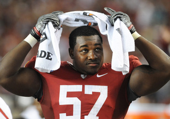 TUSCALOOSA, AL - NOVEMBER 13: Defensive lineman Marcell Dareus #57 of the Alabama Crimson Tide watches play against the Mississippi State Bulldogs November 13, 2010 at Bryant-Denny Stadium in Tuscaloosa, Alabama.  (Photo by Al Messerschmidt/Getty Images)