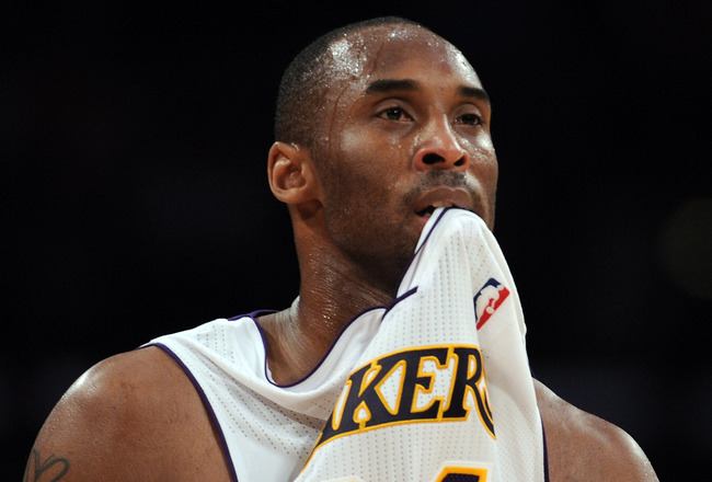 LOS ANGELES, CA - MARCH 20:  Kobe Bryant #24 of the Los Angeles Lakers watches play while biting his jersey against the  Portland Trail Blazers at the Staples Center on March 20, 2011 in Los Angeles, California.  NOTE TO USER: User expressly acknowledges