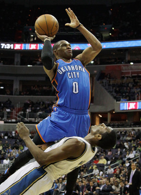 WASHINGTON, DC - MARCH 14: Russell Westbrook #0 of the Oklahoma City Thunder puts up a shot in front of John Wall #2 of the Washington WizardWashington Wizards during the first half at the Verizon Center on March 14, 2011 in Washington, DC. NOTE TO USER: