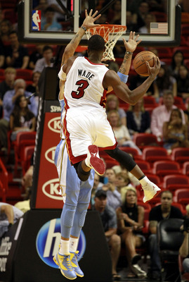 MIAMI, FL - MARCH 19:  Guard Dwyane Wade #3 of the Miami Heat shoots against the Denver Nuggets at American Airlines Arena on March 19, 2011 in Miami, Florida. The Heat defeated the Nuggets 103-98. NOTE TO USER: User expressly acknowledges and agrees that