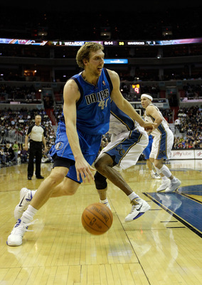 WASHINGTON, DC - FEBRUARY 26: Dirk Nowitzki #41 of the Dallas Mavericks drives against the Washington Wizards at the Verizon Center on February 26, 2011 in Washington, DC. NOTE TO USER: User expressly acknowledges and agrees that, by downloading and or us
