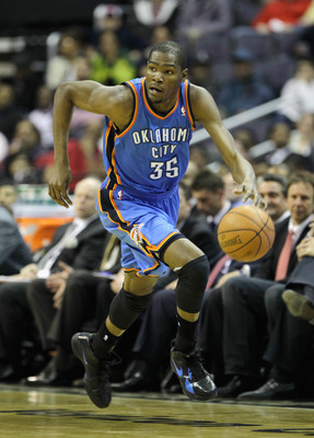 WASHINGTON, DC - MARCH 14: Kevin Durant #35 of the Oklahoma City Thunder brings the ball up the floor against the Washington Wizards  during the first half at the Verizon Center on March 14, 2011 in Washington, DC. NOTE TO USER: User expressly acknowledge
