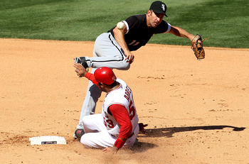 ANAHEIM, CA - SEPTEMBER 26:  Second baseman Omar Vizquel #11 of the Chicago White Sox throws to first to complete a double play after forcing out Bobby Abreu #53 of the Los Angeles Angels of Anaheim to end the fifth inning on September 26, 2010 at Angel S