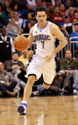 ORLANDO, FL - FEBRUARY 08:  J.J. Redick #7 of the Orlando Magic drives up the court during the game against the Los Angeles Clippers at Amway Arena on February 8, 2011 in Orlando, Florida.  NOTE TO USER: User expressly acknowledges and agrees that, by dow