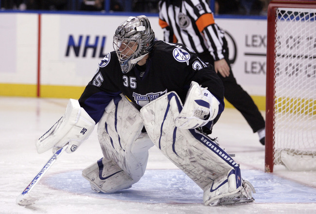 TAMPA, FL - JANUARY 25: Dwayne Roloson #35 of the Tampa Bay Lightning protects the net against the Toronto Maple Leafs at St. Pete Times Forum on January 25, 2011 in Tampa, Florida. The Lightning defeated the Leafs 2-0. (Photo by Justin K. Aller/Getty Ima