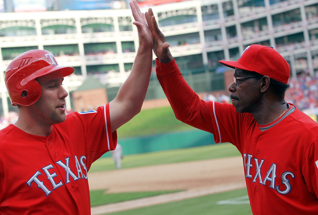 ARLINGTON, TX - APRIL 01:  David Murphy #7 of the Texas Rangers celebrates with Ron Washington Manager of the Texas Rangers after Hamilton hit the game winning RBI double in the bottom of the eighth inning against the Boston Red Sox on Opening Day at Rang