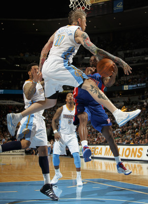 DENVER, CO - MARCH 12:  Chris Andersen #11 of the Denver Nuggets guards the route to the basket as he defends against Ben Gordon #12 of the Detroit Pistons at the Pepsi Center on March 12, 2011 in Denver, Colorado. The Nuggets defeated the Pistons 131-101
