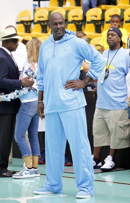 NEW YORK CITY, NY - AUGUST 13: Michael Jordan looks on during the World Basketball Festival at Rucker Park on August 13, 2010 in New York City.  (Photo by Chris Trotman/Getty Images for Nike)