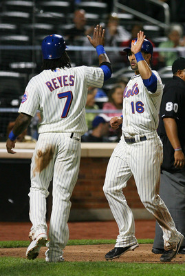 NEW YORK - SEPTEMBER 14: Jose Reyes #7 of the of the New York Mets celebrates with temmate Angel Pagan #16 after running in a two-run double from Carlos Beltran #15 (not seen) of the Mets during the fourth inning against Pittsburgh Pirates on September 14