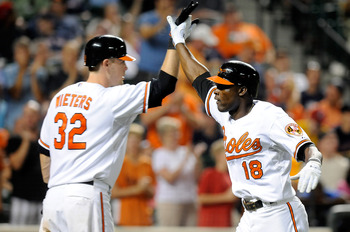 BALTIMORE - AUGUST 31:  Felix Pie #18 of the Baltimore Orioles celebrates with Matt Wieters #32 after hitting a home run in the eighth inning against the Boston Red Sox at Camden Yards on August 31, 2010 in Baltimore, Maryland.  (Photo by Greg Fiume/Getty