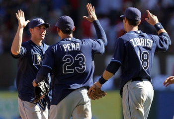 ARLINGTON, TX - OCTOBER 10:  Carlos Pena #23 and Ben Zobrist #18 of the Tampa Bay Rays celebrate with Matt Joyce #20 after a 5-2 win against the Texas Rangers during game 4 of the ALDS at Rangers Ballpark in Arlington on October 10, 2010 in Arlington, Tex