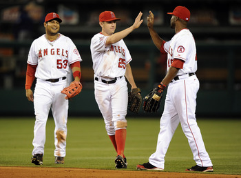 ANAHEIM, CA - SEPTEMBER 20:  Peter Bourjos #25, Bobby Abreu #53 and Torii Hunter #48 of the Los Angeles Angels of Anaheim celebrate a 7-4 win over the Texas Rangers during the ninth inning at Angel Stadium on September 20, 2010 in Anaheim, California.  (P